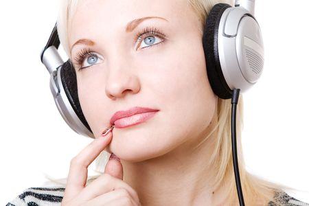 a pensive girl in headphones listening music photo