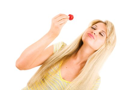 tasty strawberry in hands of the girl photo