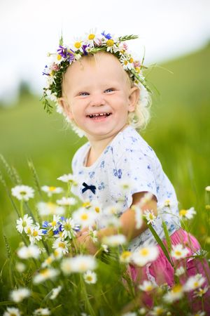 happy small girl with field flowers photo