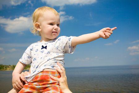 child sitting up shows forward photo
