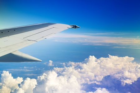 Wing of the plane on a background of sky Stock Photo