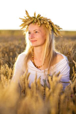 happy girl in field of wheat photo
