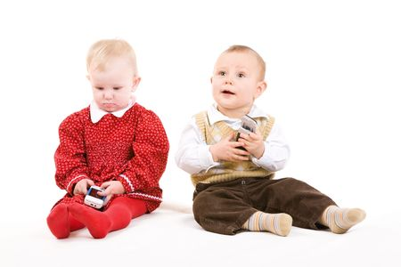 two children on the floor with phones photo