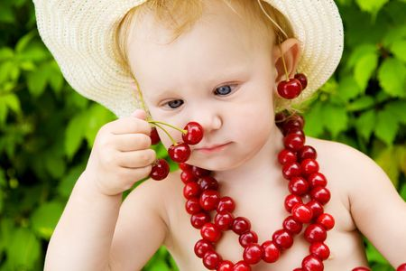 small girl with red cherry beads and earings