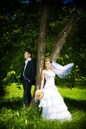 newly-married couple near the tree