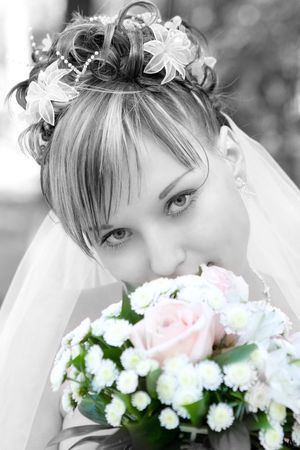 bride in black and white with a flower bouquet in color photo