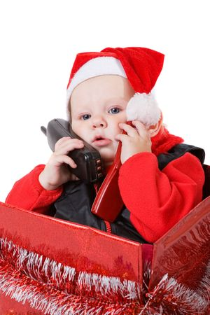 infant calling by phone in the decorated christmas box photo