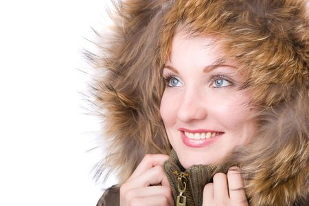 happy woman in a jacket with a fur collar photo