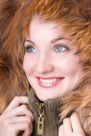 Young smiling woman in a jacket with a fur collar photo