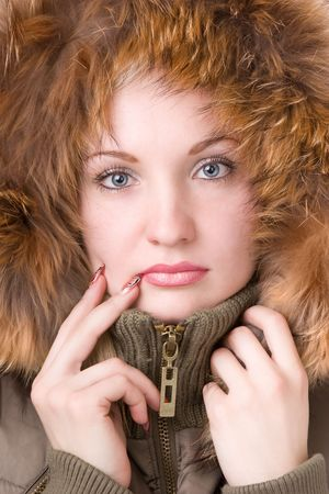 Young woman in a jacket with a fur collar photo