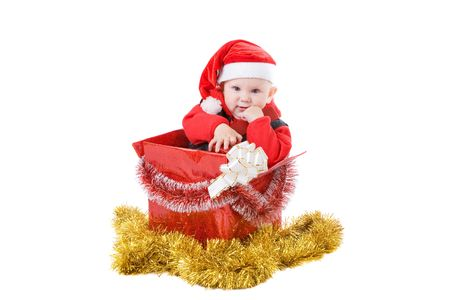 infant with gifts in the decorated christmas box photo