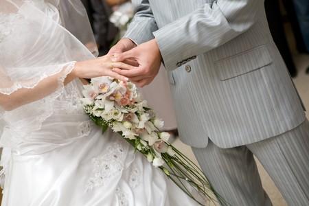 put on a wedding ring photo
