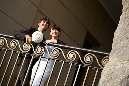 couple near the fence in the city photo