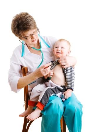 doctor and child on the chair photo