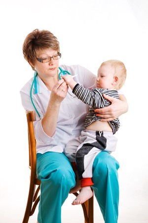 child and doctor with thermometr photo
