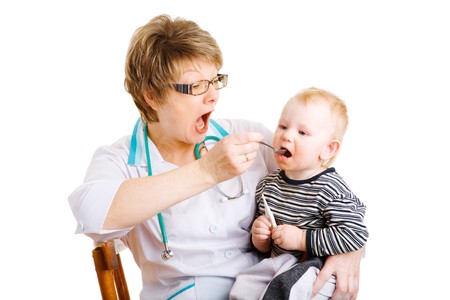 babycare: doctor gives remedy to child