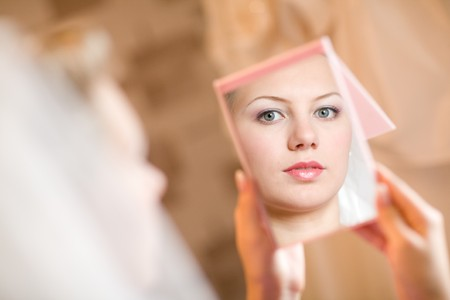 face of the girl in the mirror Stock Photo