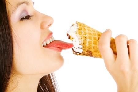 long tongue: girl licking an ice-cream