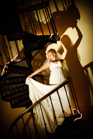 bride posing on the staircase photo