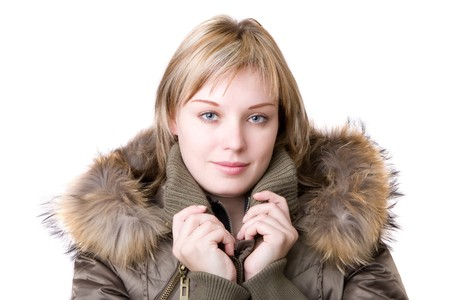 young girl in a jacket with a fur collar photo