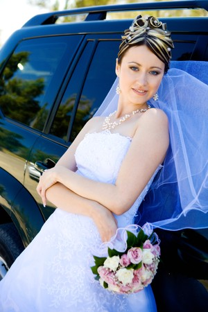 bride by the car photo