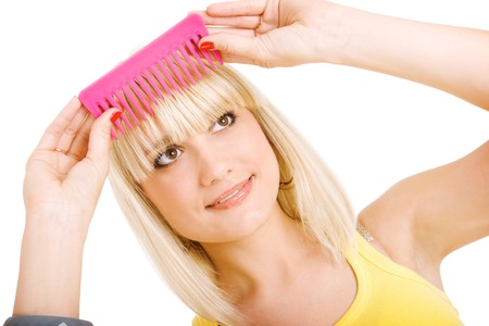 blonde girl combs her hair Stock Photo - 4277624