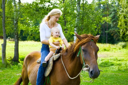 mom and child on the horse