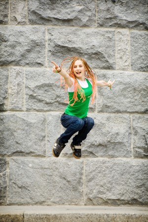 jumping happy girl in the city photo