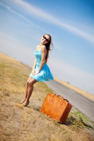 near: laughing girl near the suitcase