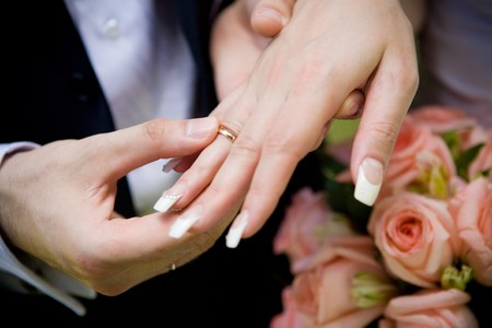 puttting on a wedding ring Stock Photo - 4335022