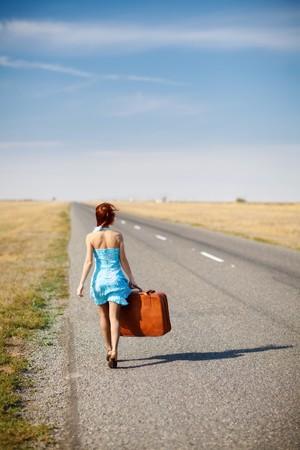girl walks along the road photo