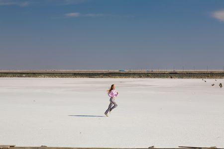 happy running girl on the sand Stock Photo - 4900317
