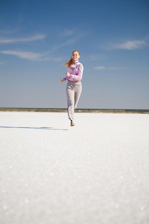 happy running girl on the sand Stock Photo - 4900298