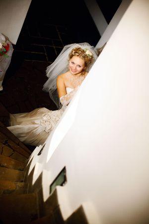 bride hides near the column Stock Photo - 4946829