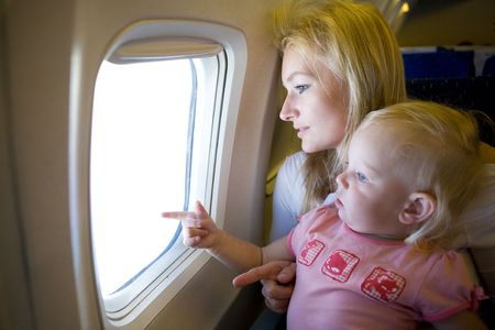 mom and child in the airplane