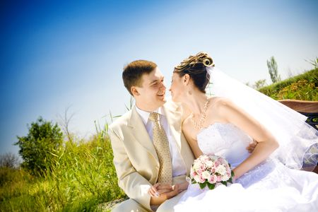 happy bride and groom outdoors