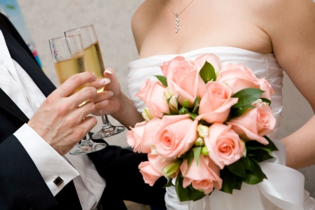 champagne in hands of bride and groom Stock Photo