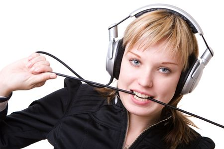 a girl plays with a cable of the earphones listening to the music Stock Photo - 5246231