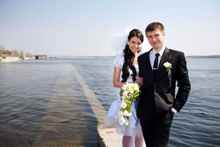 bride and groom, view to the water photo