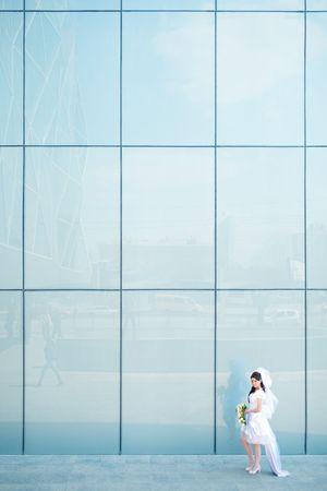 bride near the blue wall photo