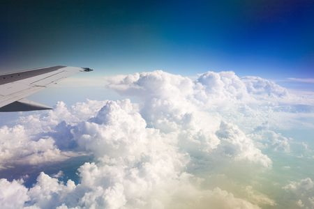 clouds and wing of the plane