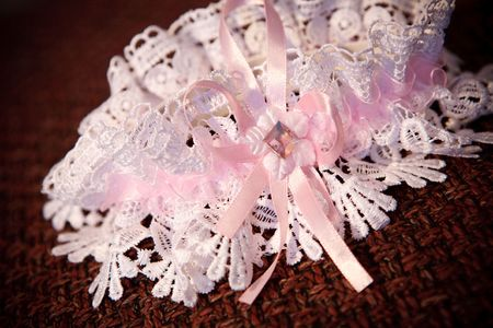 pink garter of the bride photo