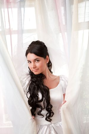 a bride by the window photo
