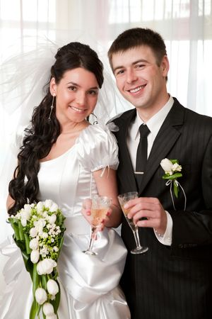 happy bride and groom with champagne photo