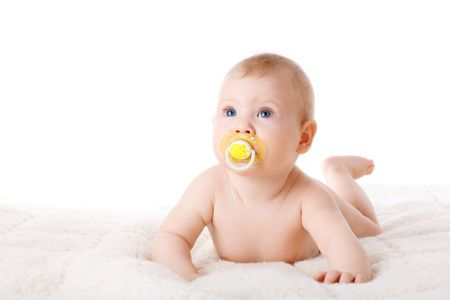 nipple girl: child with dummy on the floor Stock Photo