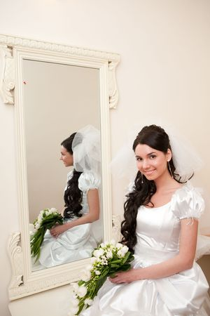 a girl by a mirror Stock Photo - 5324782