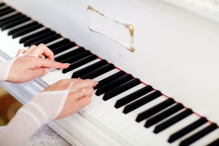 bride playing the grand piano Stock Photo - 5345435