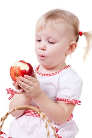 a girl eating apple isolated photo