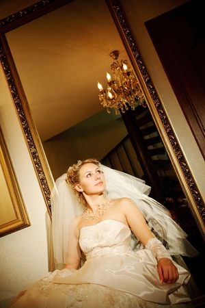 bride near the mirror at darkness Stock Photo - 5442973