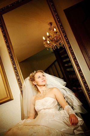 bride near the mirror at darkness Stock Photo - 5442973